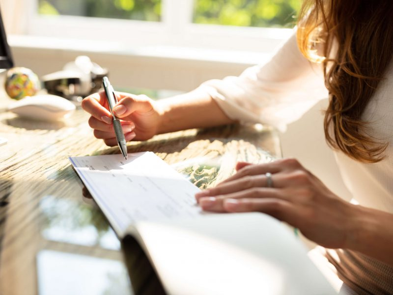 Woman writing check