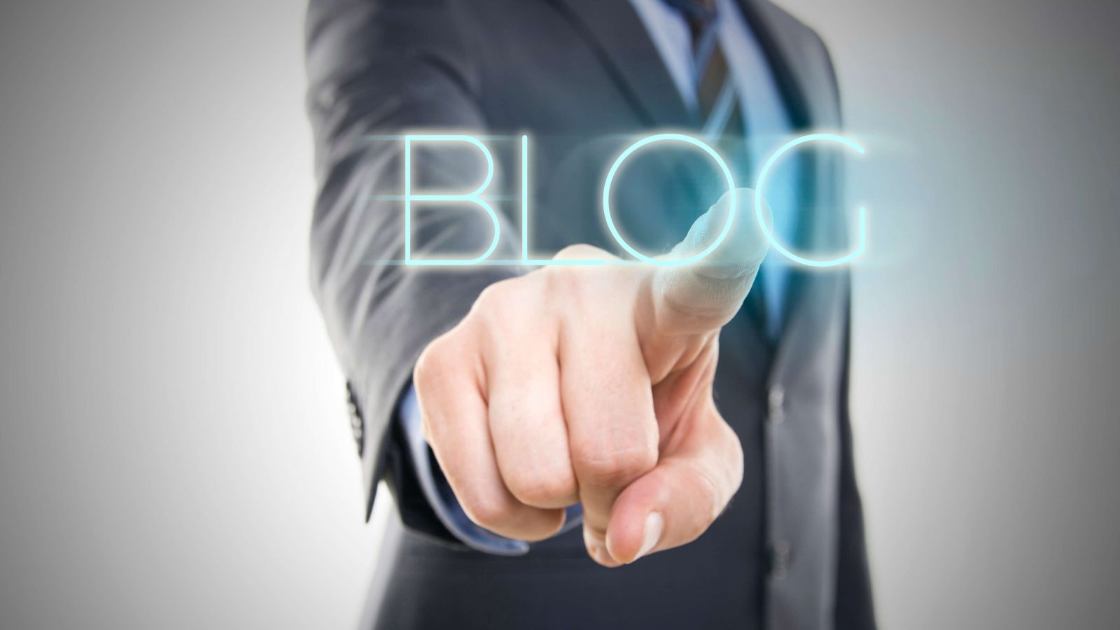 Man pointing finger at the word blog