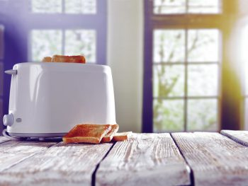 Toaster making toast on a sunny day